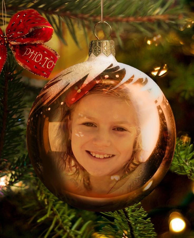 Girl's photo in orange Christmas bauble made with Xmas bauble template.