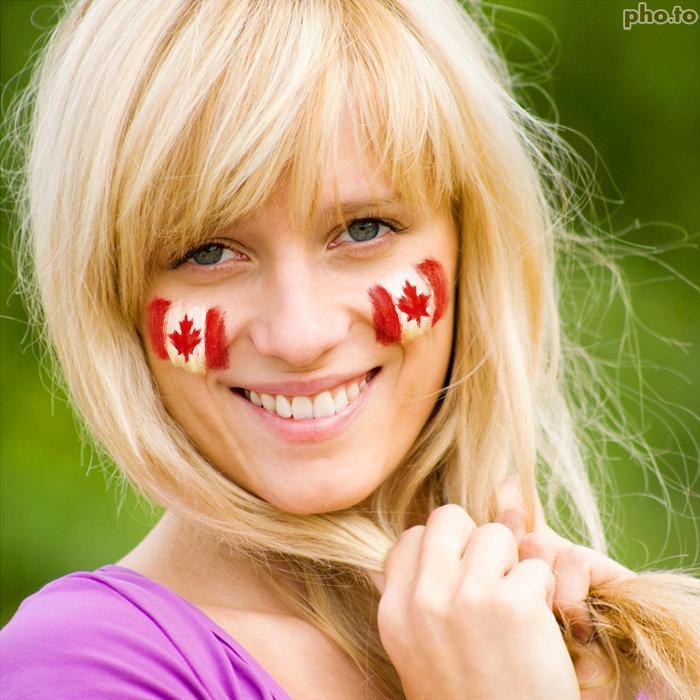 Photo of Canadian girl with patriotic flag facepaint on