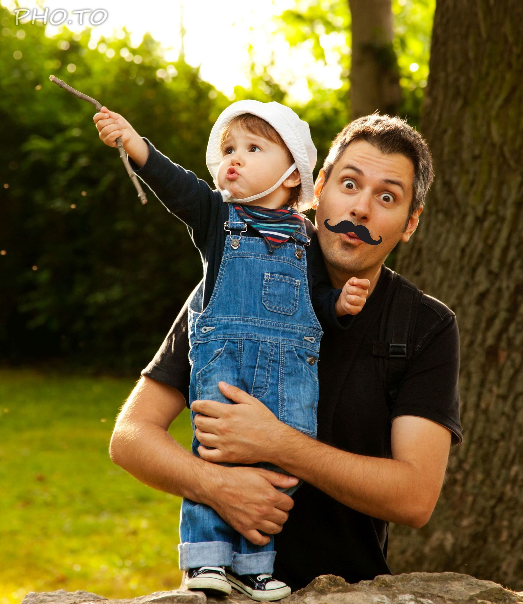Hipster mustache are added to a photo of a loving father.
