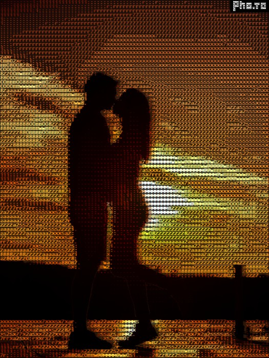 A photo of a loving couple edited with an ASCII art generator.