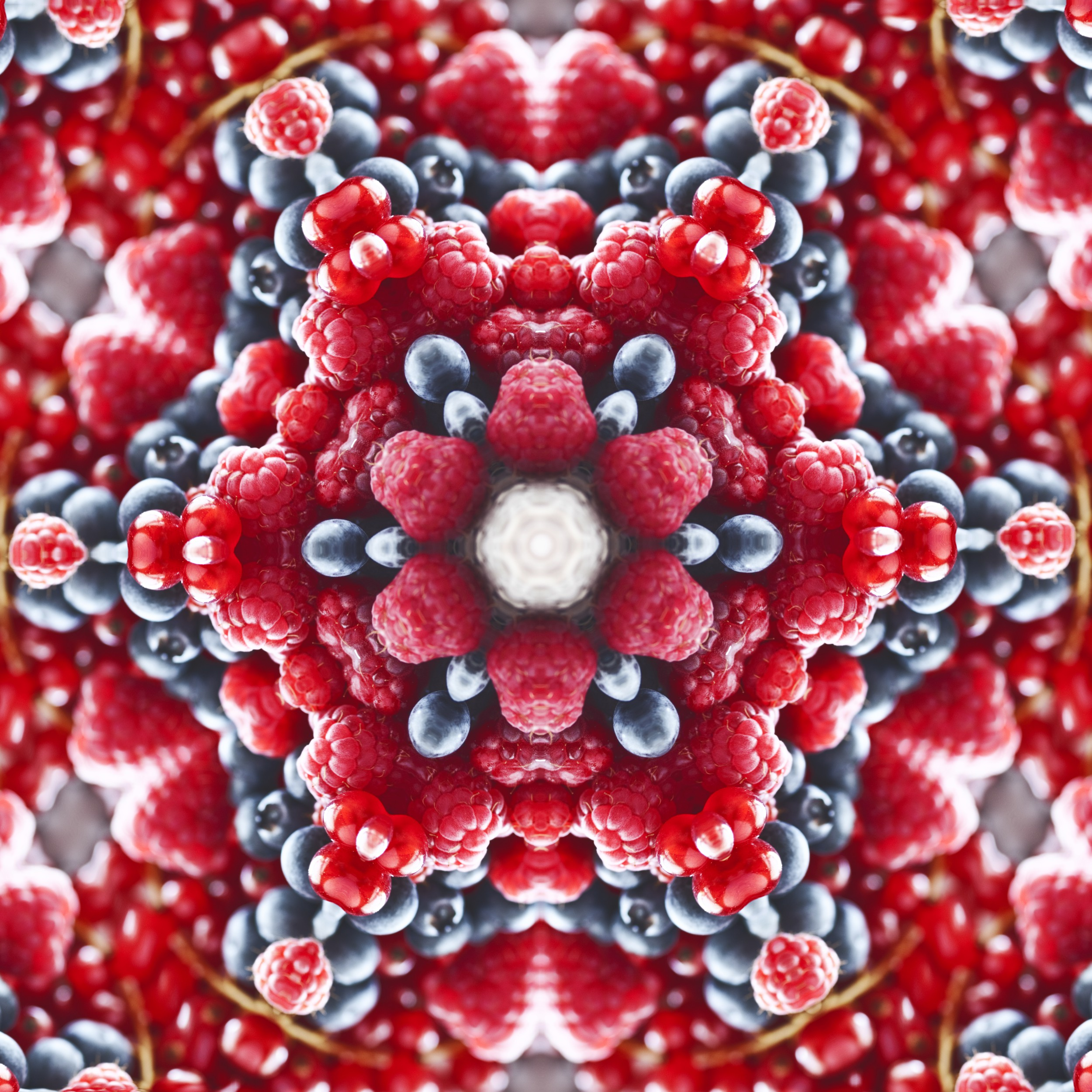 Online kaleidoscope tool was applied to a handful of juicy berries