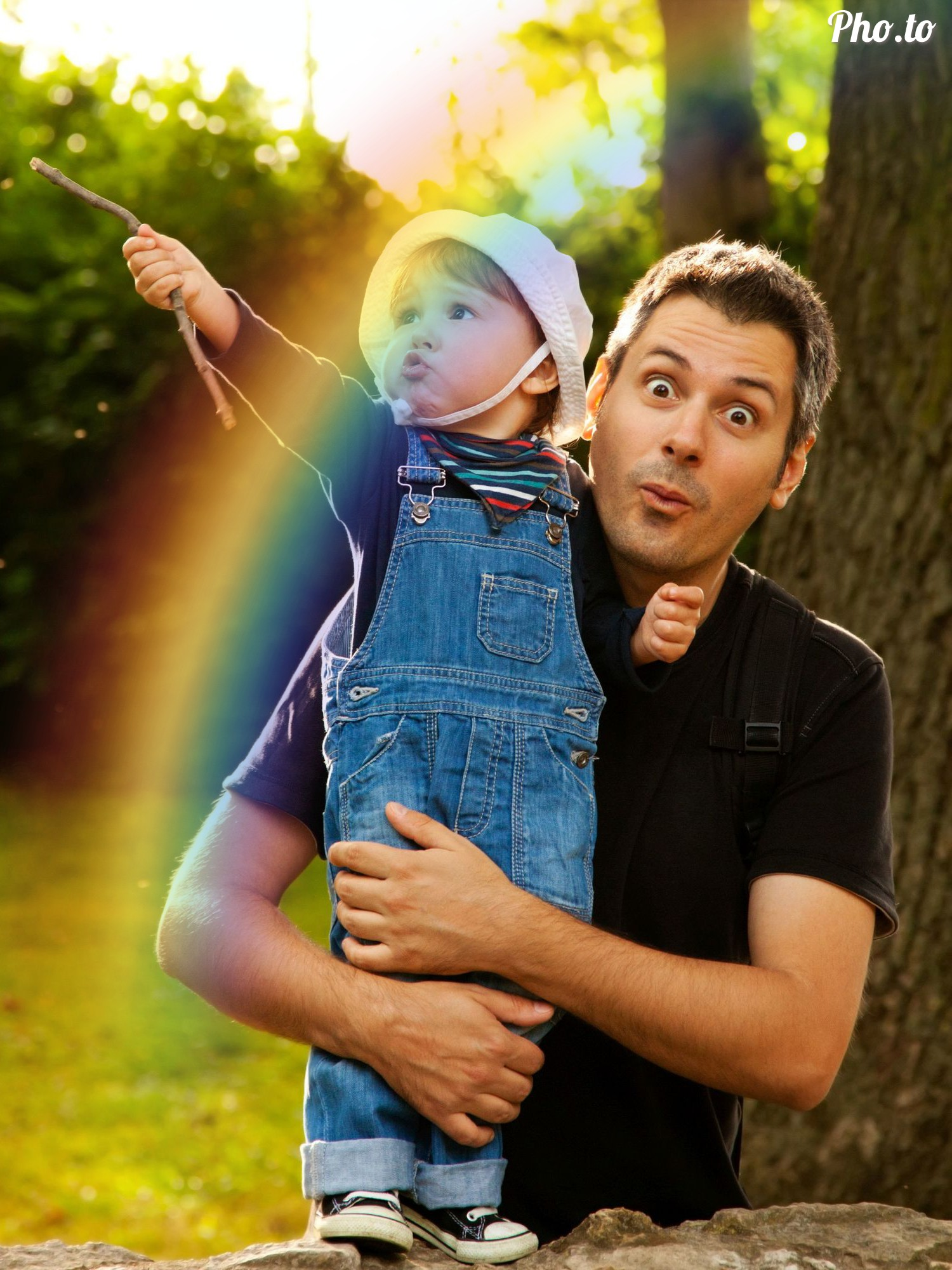 Portrait of a loving father & his son with rainbow effect.