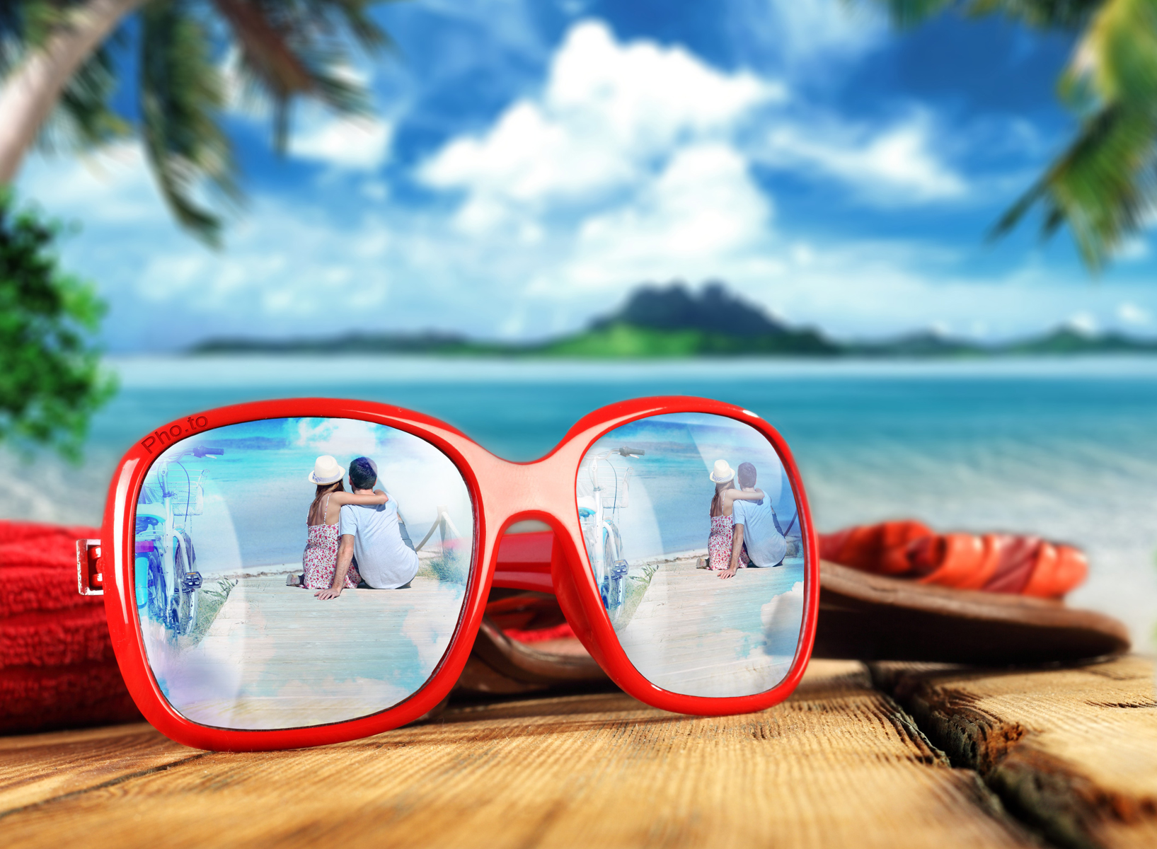 Summer photo of a loving couple with sunglasses picture frame applied