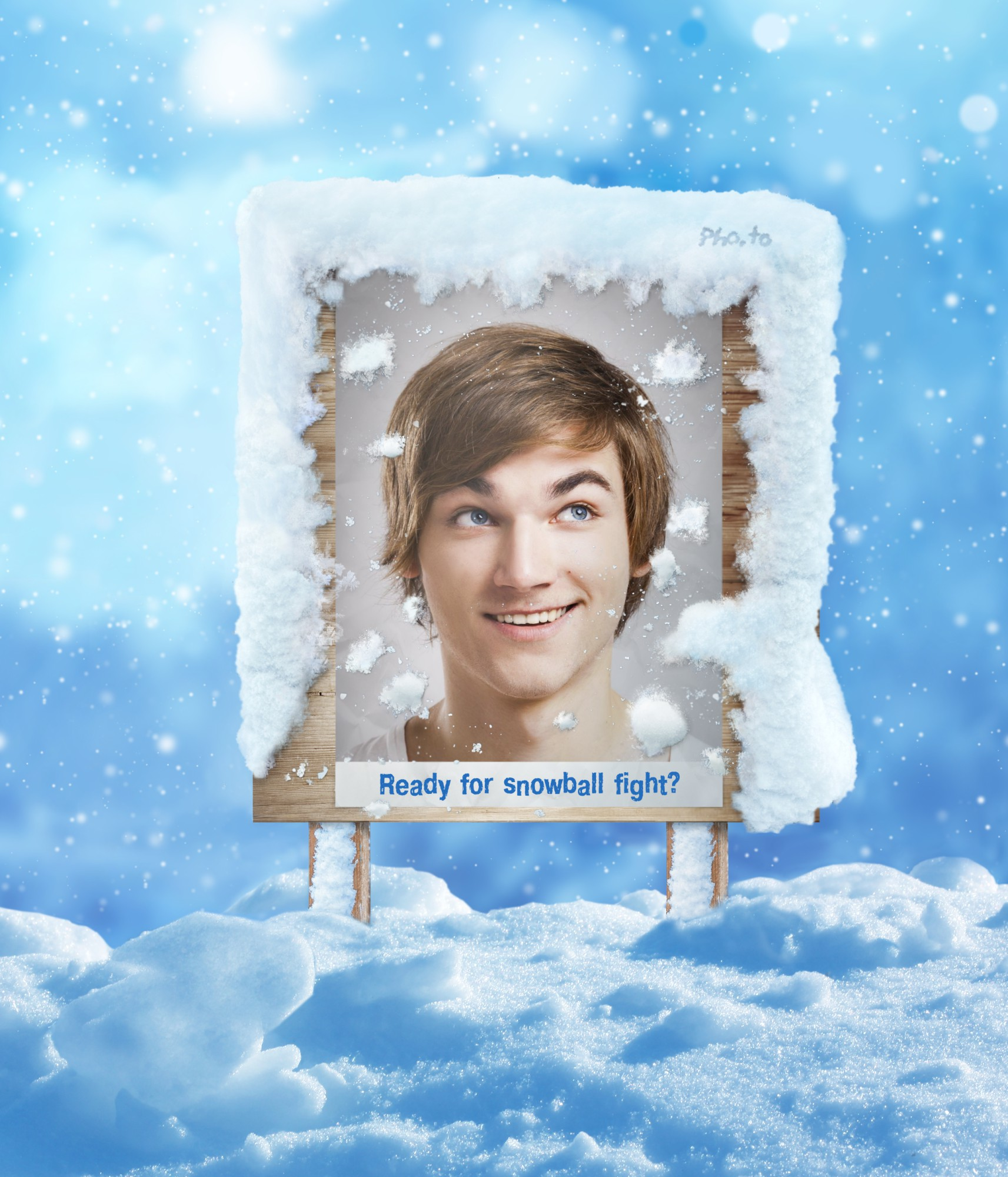 Winter scene with man's photo on the signboard in the middle of snowfight