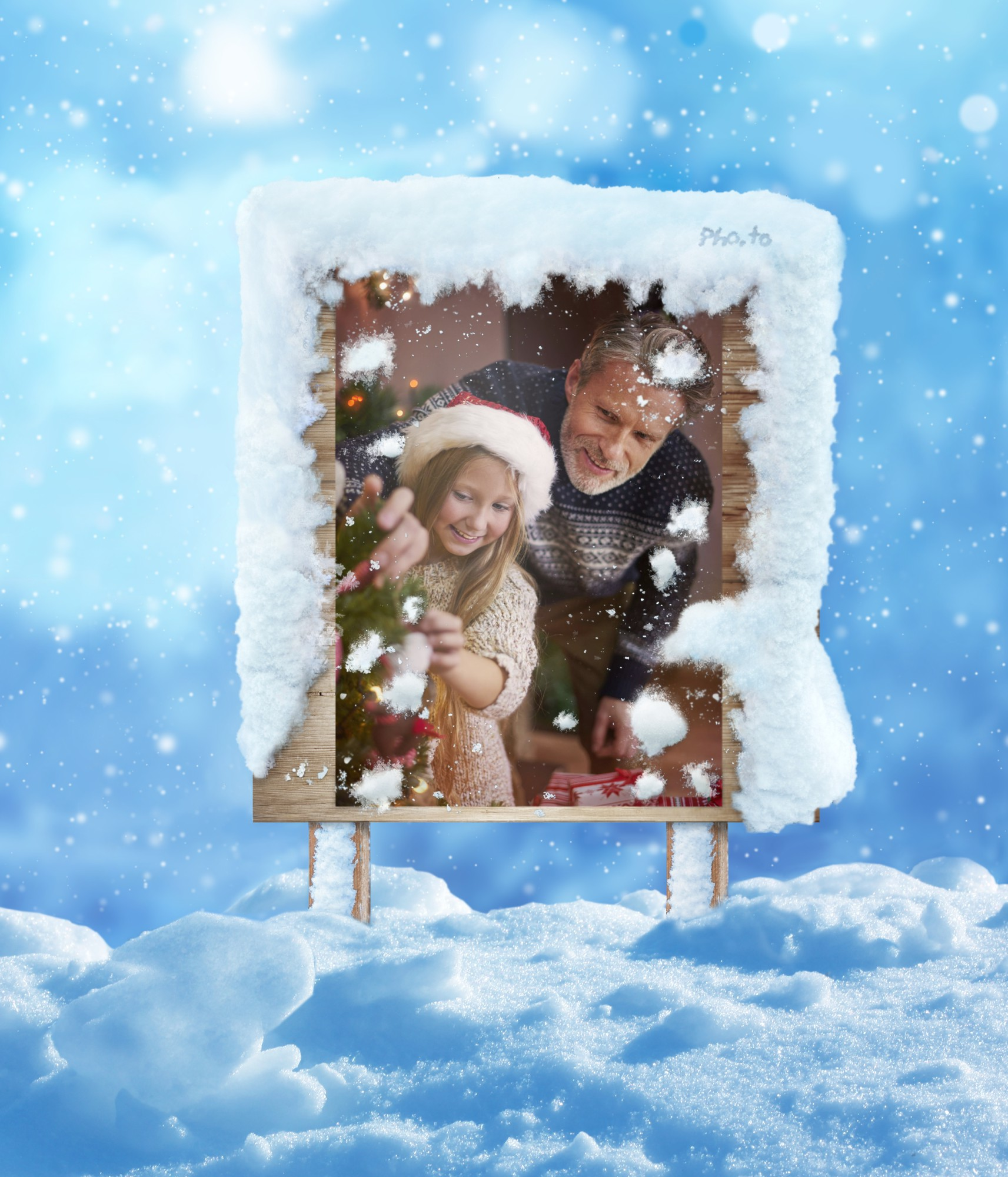 Christmas family photo is inserted into a scene with wooden signboard in the snow.