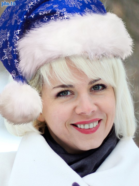 A blonde girl used a blue plush Santa hat online to cover her head.