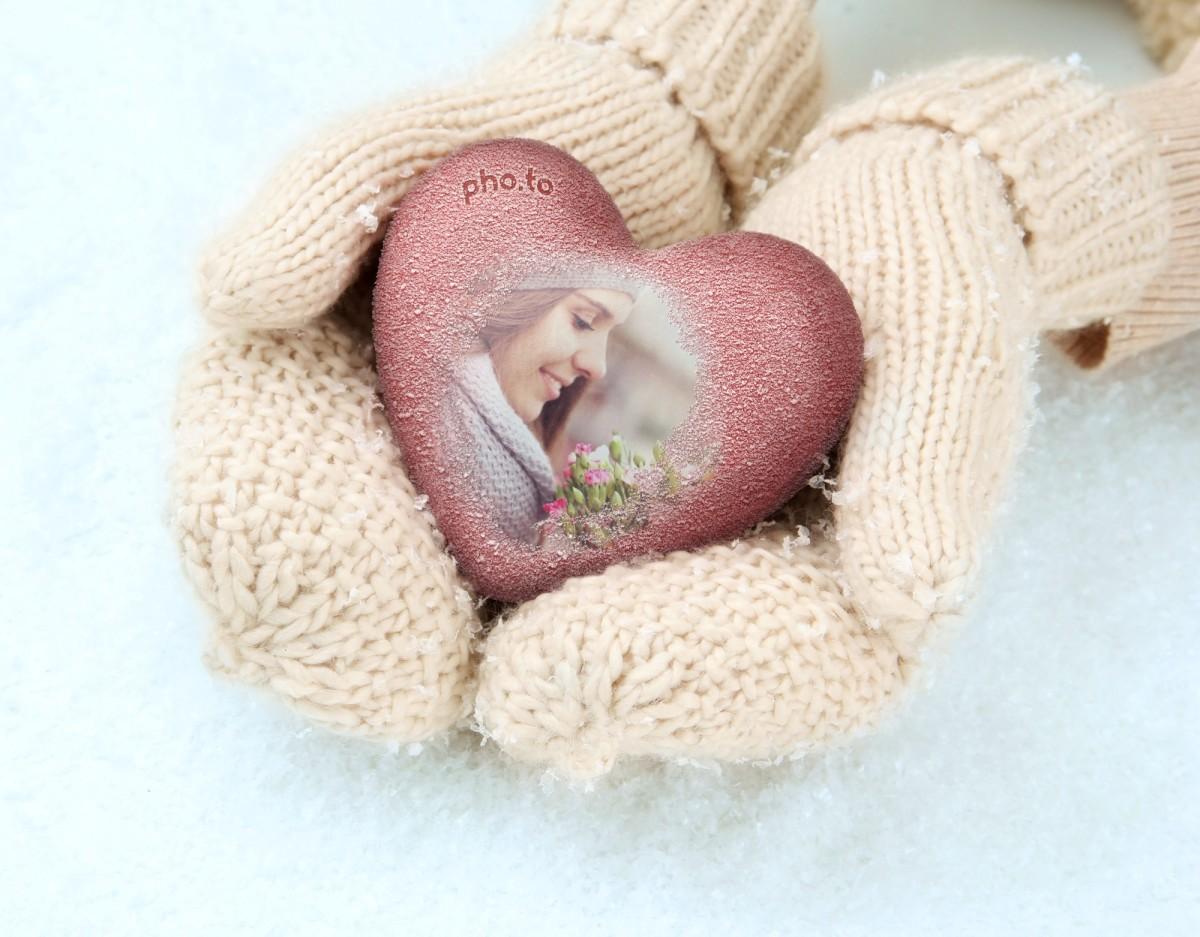 A girl's photo inside a 'Heart in hands' photo frame is a nice Valentine ecard.