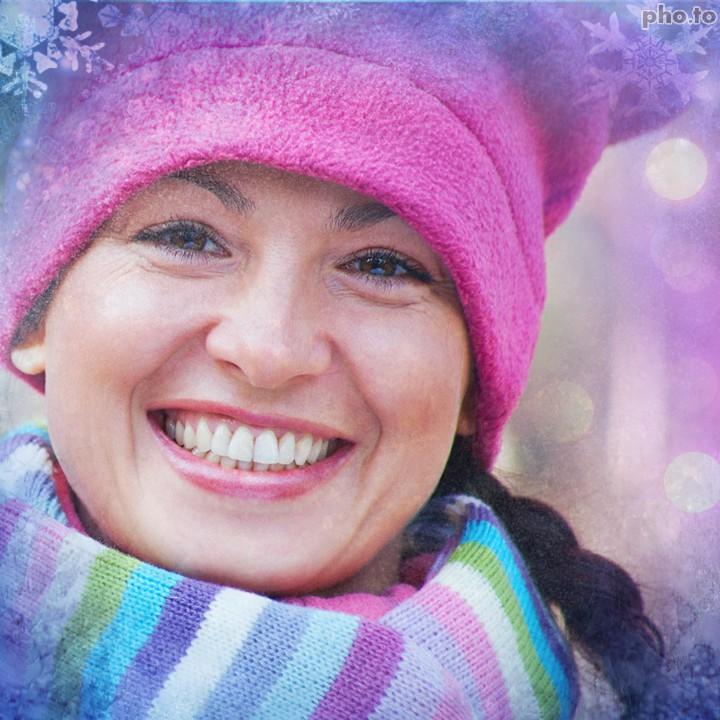 Christmas photo effect transforms woman's photo into a winter ecard.